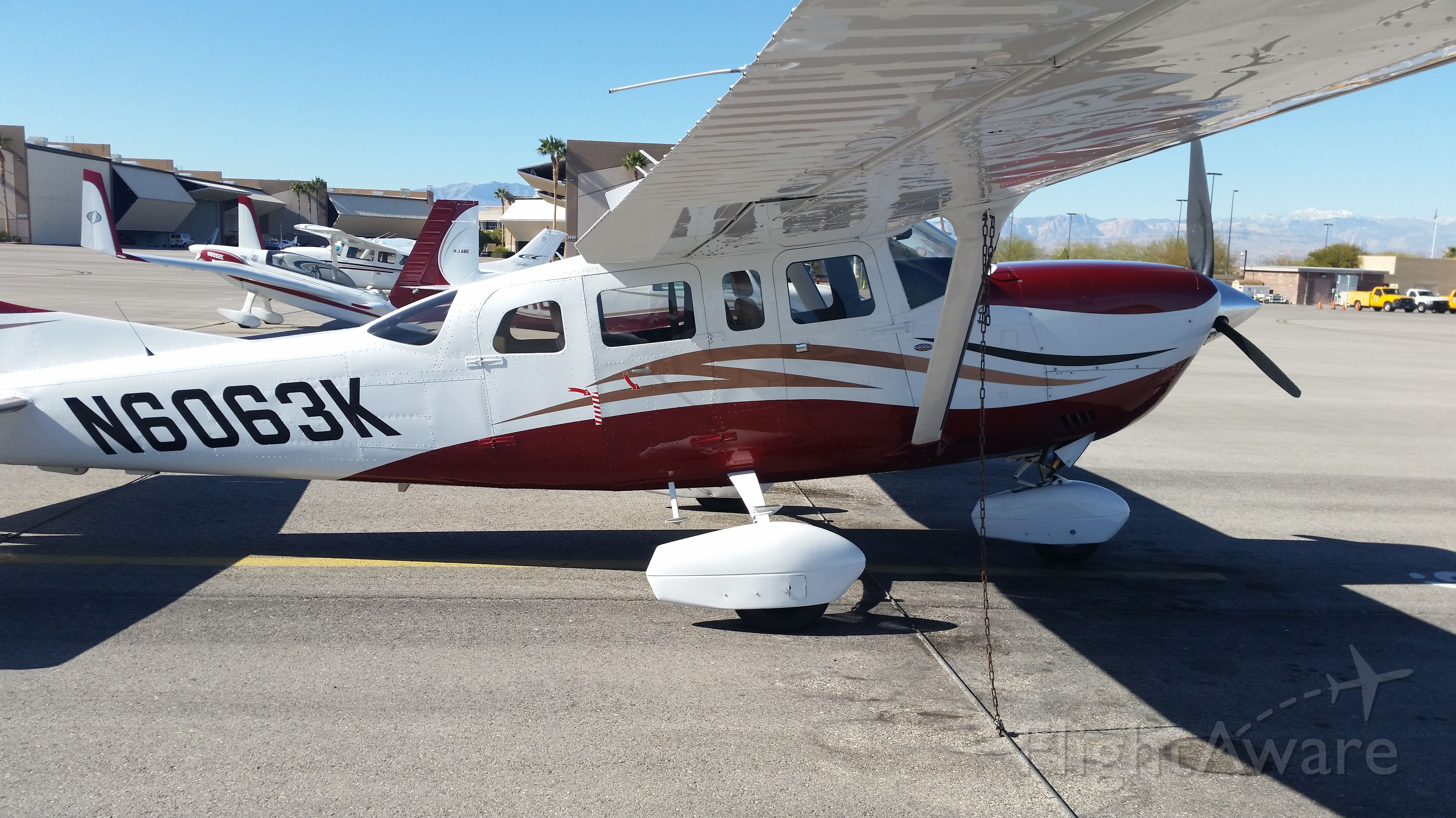 Cessna 206 Stationair (N6063K) - Saw this great looking T206 sitting on the ramp at Henderson Executive. Weeping wing, oversized tires, vortex generators, front passenger door, and tip tanks. Great back country aircraft with about every options available! Very nice!