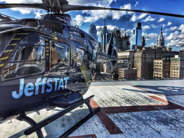 Eurocopter EC-635 (N135TJ) - JeffSTAT H135 Aeromedical Helicopter On The Helipad (9PA8) At Thomas Jefferson University Hospital In Philadelphia, Pennsylvania With A Beautiful View Of The Skyline Of The City Of Brotherly Love
