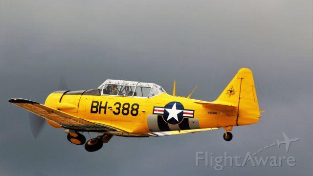 North American T-6 Texan (N49388) - Departing Runway 27 Oshkosh toward ominous skies.