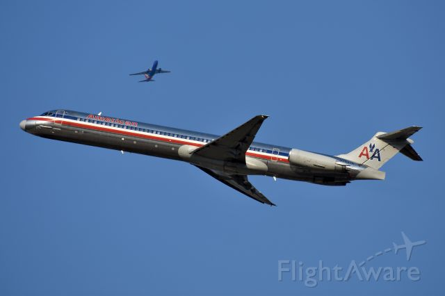 McDonnell Douglas MD-82 (N7547A) - Southwest 737-700 overhead climbing out from DAL.