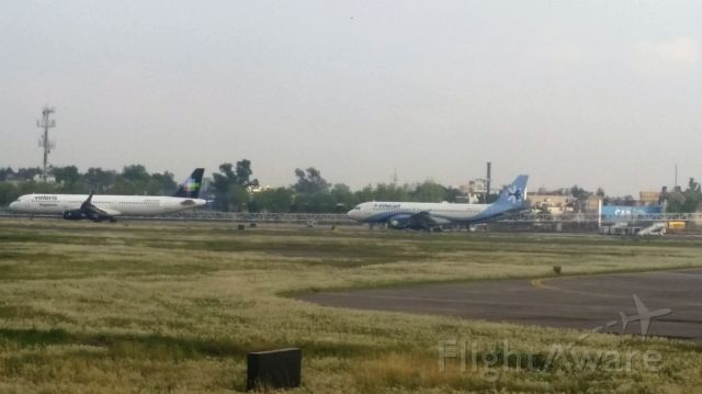 Airbus A320 — - Interjet A320 and Volaris A321 Waiting for Departure at MMMX