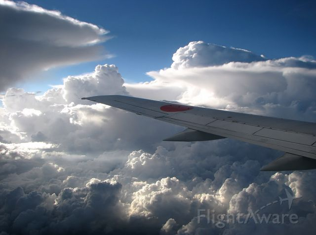 Boeing 737-700 (JA392K) - Shaken but not stirred! Flying to Sapporo, Hokkaido, out of Tokyo Haneda shortly after takeoff. Beautiful clouds.