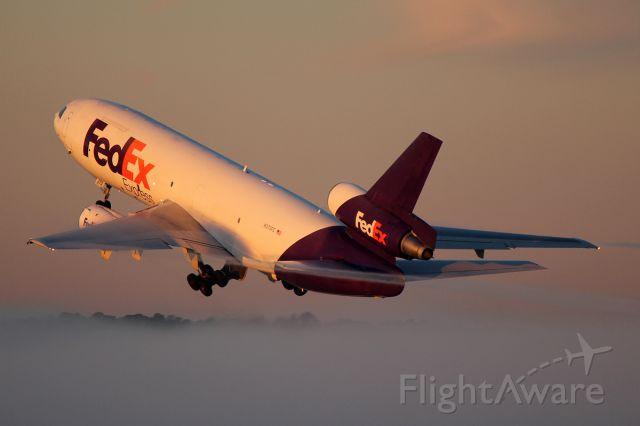 McDonnell Douglas DC-10 (N373FE) - Bursting through a thin fog bank