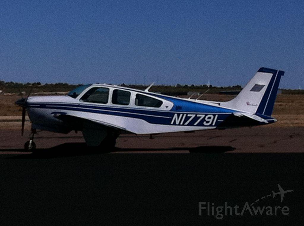 Beechcraft Bonanza (33) — - Blue over white