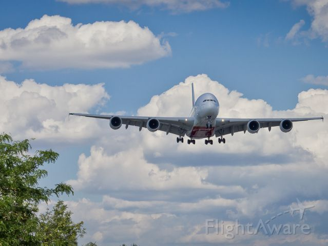 Airbus A380-800 (A6-EEH) - Just under a shadow, making her arrival from Dubai.