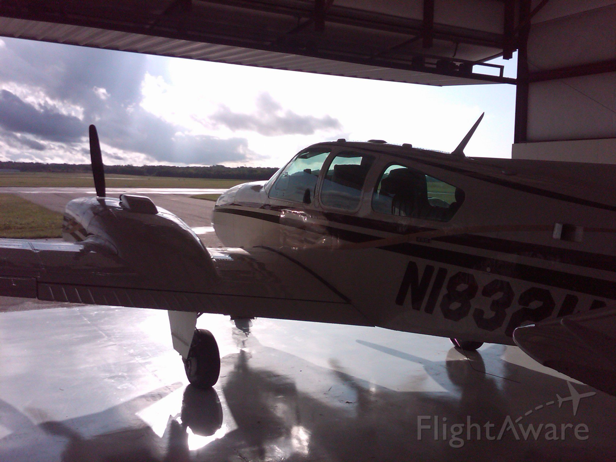 """Beechcraft 55 Baron (N1832W) - N1832W is like a sleeping dog waiting for the right moment to taxi out and """"light the fires"""". She is in her hangar at Smyrna, TN."""