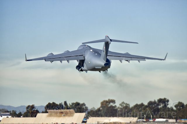 """Boeing Globemaster III (N271ZD) - A """"white tail"""" Boeing C-17 Globemaster III breaking in the brakes during takeoff on its maiden test flight from the Boeing Factory in Long Beach, CA at KLGB."""