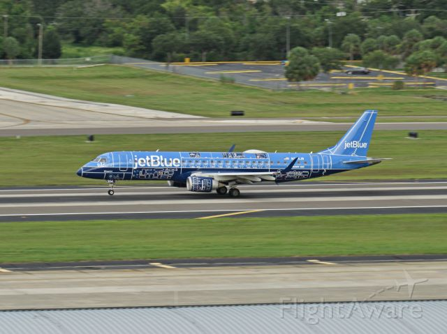 Embraer ERJ-190 (N304JB) - Jet Blues special blueprint livery speeds down the runway on takeoff.