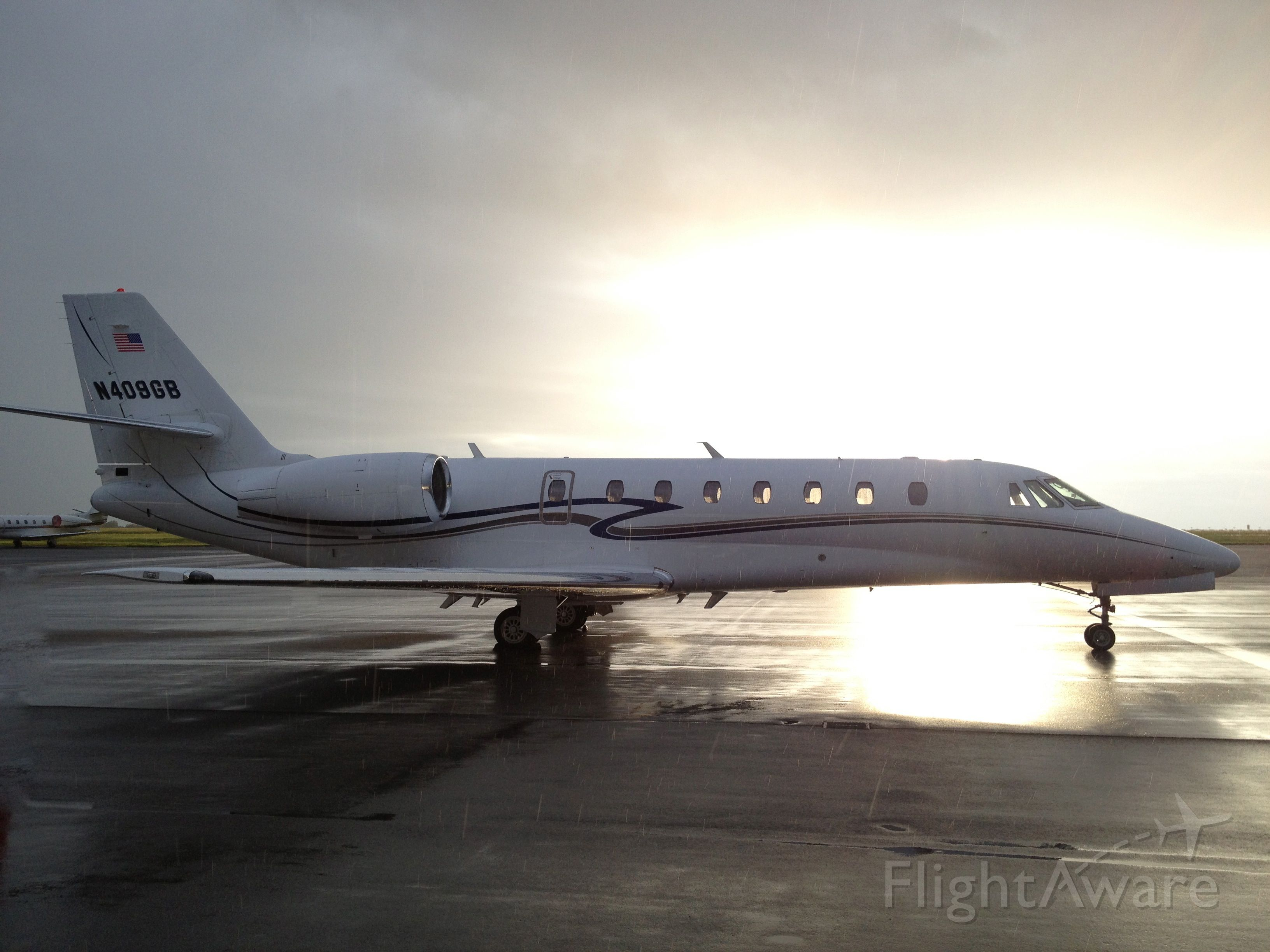 Cessna Citation Sovereign (N409GB) - Rain showers and sunshine helped package this shot of a beautiful Sovereign on the ground in Nashville, TN.