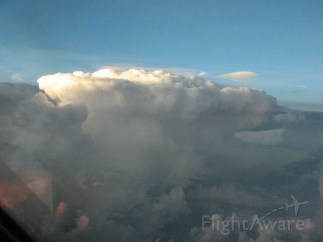 — — - Thunderstorm at FL410