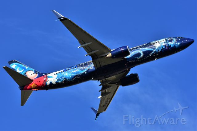 Boeing 737-800 (C-GWSZ) - WestJet (Disney's Micky Mouse Livery) Boeing 737-8CT departing YYC on May 11.