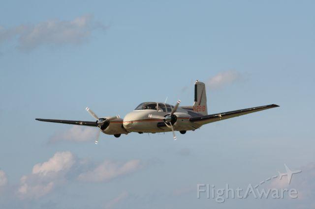 Beechcraft Twin Bonanza (N261B) - Fly-by of the mighty D50 Twin Bonanza.