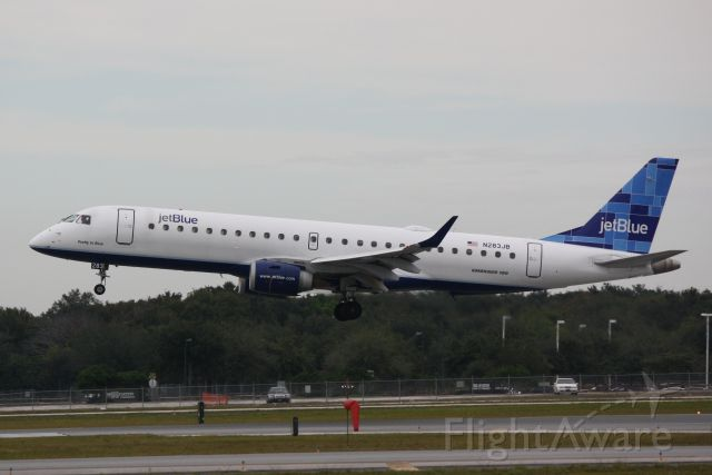 """Embraer ERJ-190 (N283JB) - JetBlue Flight 741 (N283JB) """"Pretty in Pink""""  arrives at Sarasota-Bradenton International Airport following a flight from Boston-Logan International Airport"""