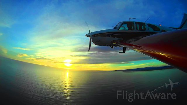 Beechcraft Bonanza (33) (N8943U) - Sunset flight over Monterey Bay and Santa Cruz.