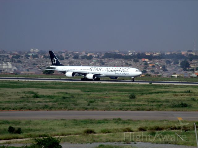 Airbus A340-600 (ZS-SNI) - Taking off runway 23