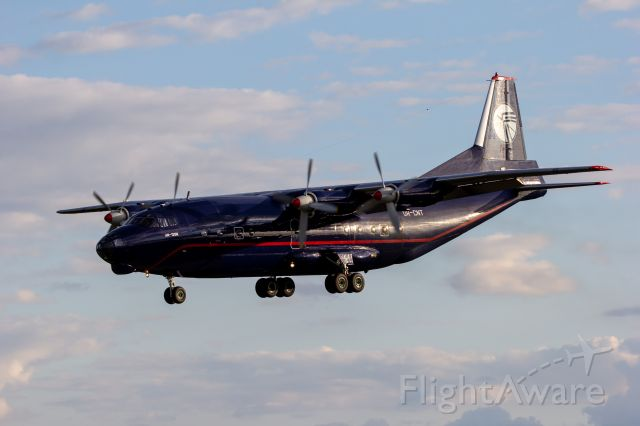 Antonov An-12 (UR-CNT) - UKL5010 on final for the former 5L at Willow Run.