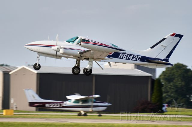 Cessna 310 (N6142C) - Departing Runway 26