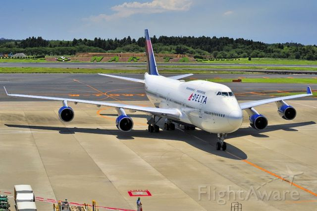 Boeing 747-400 (N673US) - 2014 - Arriving at Gate with Narita sign behind. For the many B-747 lovers out there...