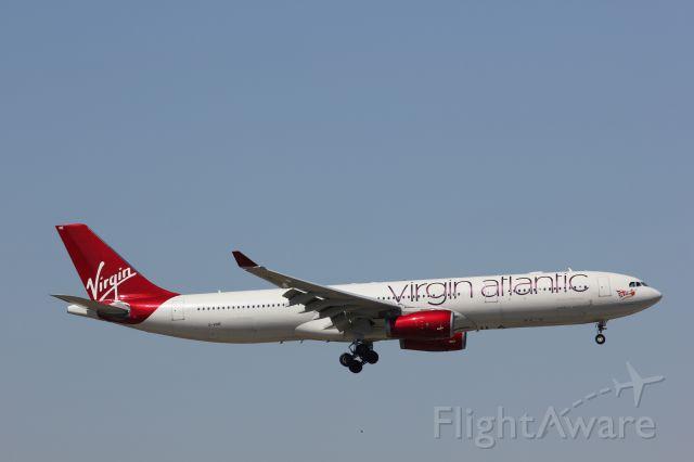 "Airbus A330-300 (G-VINE) - ""Champagne Belle"" landing in Atlanta."