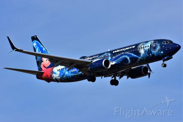 Boeing 737-800 (C-GWSZ) - WestJet (Disney's Micky Mouse Livery) WestJet (Disney's Micky Mouse Livery) arriving at YYC on May 11.