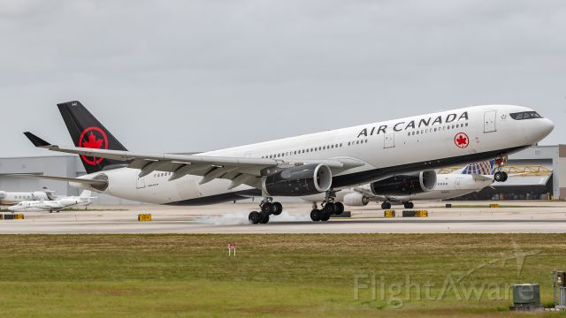 Airbus A330-300 (C-GEGC) - Air Canada A330-300 landing on runway 10R at KFLL
