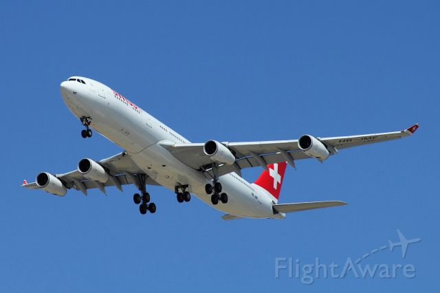 HB-JMF — - Swiss Airbus 340 on final to runway 30, fly in from Zurich on 07/2015.