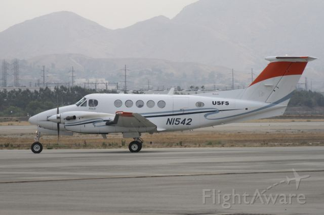 Beechcraft Super King Air 200 (N1542) - Taxiing for takeoff at San Bernardino International Airport, August 10 2018. This aircraft was working with the US Forest Service doing aerial survey work during the Holy Fire in Orange and Riverside Counties.
