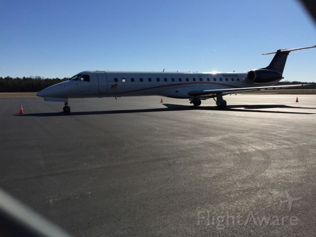 Embraer ERJ-145 (N975RP) - Sitting on the tarmac at Charlotte/Monroe.br /Photo taken with an IPhone 6 on 1/8/2015.