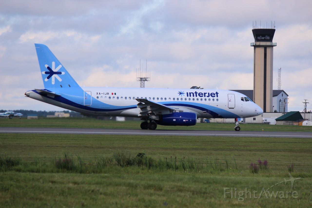 Sukhoi Superjet 100 (XA-IJR) - The second Sukhoi SSJ95 of InterJet of Mexico rolls past the control tower at Bangor International Airport at the end of an import flight.