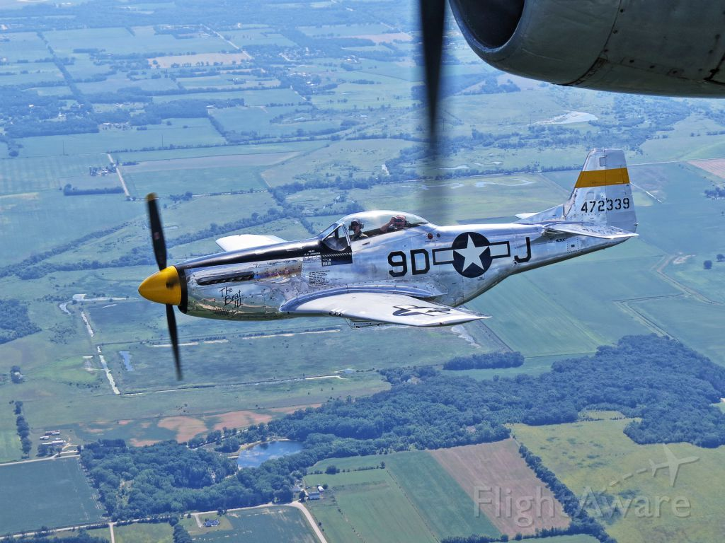 North American P-51 Mustang (N251JC) - Mustang escorting B29 Super Fortress out of KRFD