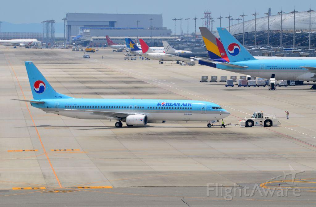 Boeing 737-900 (HL7599) - Airline: Korean Airlines (KE/KAL); Airport: Kansai International Airport (KIX/RJBB); Camera: Nikon D7000; Date: 4 July 2012