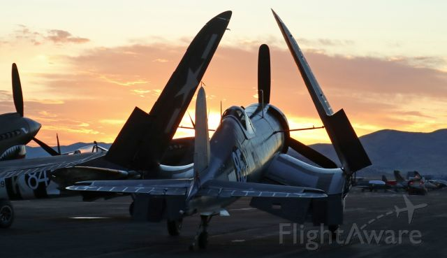 N209TW — - The first day of the 2017 Reno Air Races (aka: National Championship Air Races) started in spectacular fashion this morning when the Texas Flying Legends Museum personnel positioned their aircraft on the ramp for a sunrise photo op.  This shot captures their Goodyear FG-1D Corsair (N209TW / NX209TW) from behind as the sun is coming up over Reno Stead Airport.br /br /Recommend clicking on FULL for best viewing.
