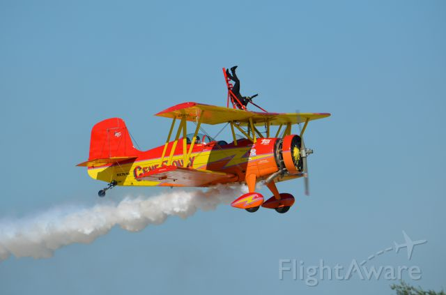 AMU7699 — - Gene Soucy and Teresa Stokes in their Grumman Showcat performing at EAA 2011.