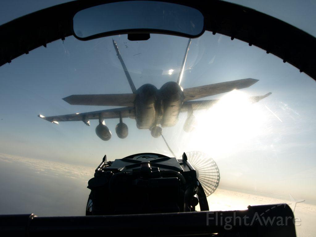 — — - Refueling an F/A-18F Super Hornet
