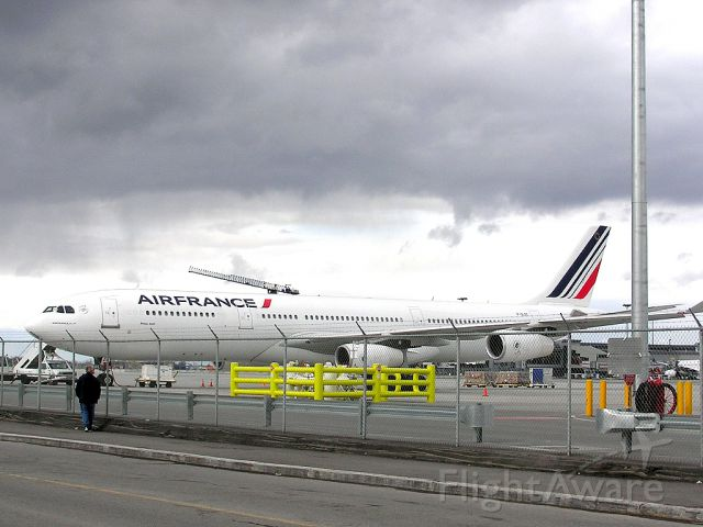 Airbus A340-300 (F-GLZC) - Parked...waiting for the evening flight to CDG!