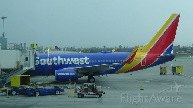 Boeing 737-700 (N438WN) - Boarding Passengers at Southwest's terminal.