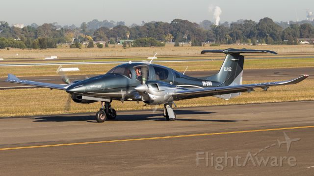 Diamond DA-62 (VH-DNU) - A brand spanking new Diamond DA-62 Taxiing Out To RWY 29C for a departure for Dubbo. This is the 27th DA62 ever built and a first here Down Under!