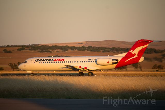 Fokker 100 (VH-NHJ) - NHJ taxiing to the end of RW21 at Geraldton Airport to line up for take-off back to to Perth.