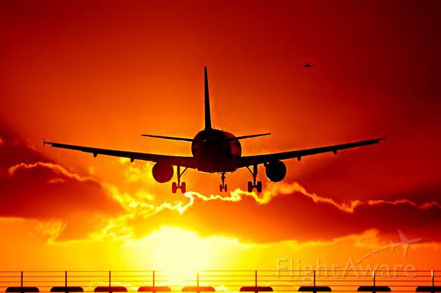 Airbus A321 (G-MARA) - Very Nice shot with Sunset