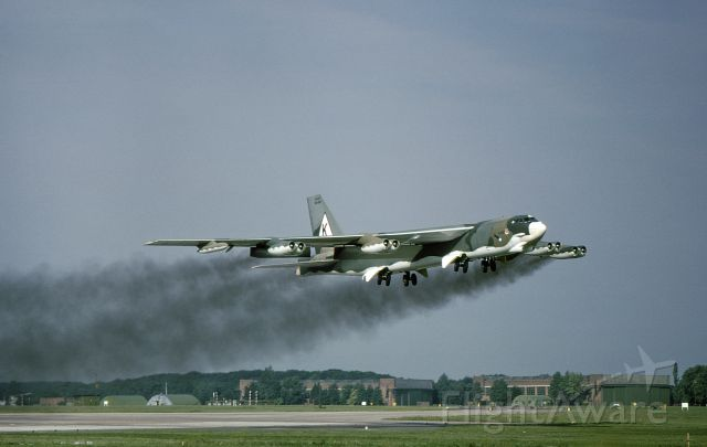 """Boeing B-52 Stratofortress (58-0189) - B52G 58-0189 assigned 8th AF, 379th BW, Wurtsmith AFB, MI.  Water injection takeoff from RAF Marham in August of 1980.  We were returning to KOSC after participating in the Giant Strike bombing competition with the RAF Vulcans.  The """"triangle K"""" on the tail was in commemoration of the 379th BG which flew B17s out of RAF Kimbolton during WWII.  It was a major accomplishment to get CINCSAC, General Ellis, to approve the non-standard markings.  I was the Crew Chief and Im in the IP seat."""