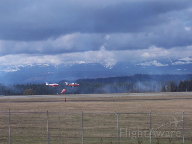 """— — - Pair of Snowbirds land in our """"snow-less Comox Valley""""  not-so at higher elevations  of the Baufort Range  CFB Comox air-base"""