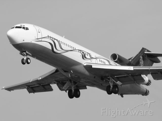 Boeing 727-100 (N169KT) - Trust me, with a murky sky and the aircraft sporting a faded maroon livery, this classic B727-200 looked better in Black and White.
