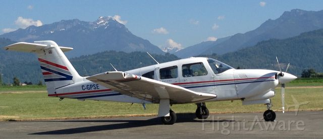 Piper Cherokee (C-GPSE) - Turbo Arrow IV at Chilliwack with the Coastal Mountains in the background.