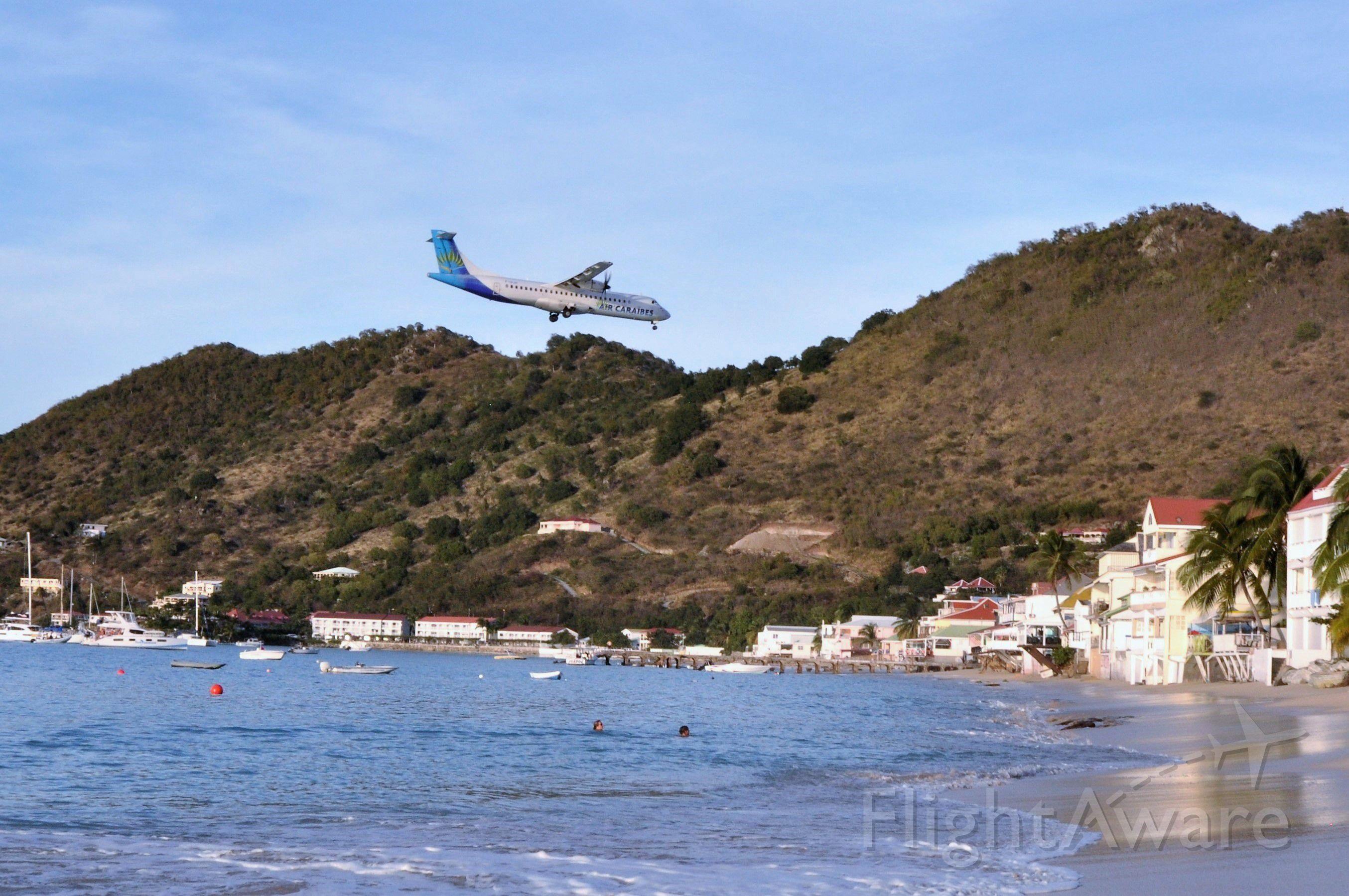 ATR ATR-72 — - Standing on the beach of Grand Case Village, St. Martin.