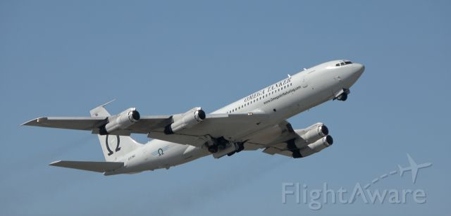 Boeing 707-300 (N707MQ) - The Omega departing out to the East from Spokane Int. Airport