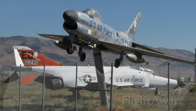North American F-86 Sabre (53-1045) - This photo, the first-ever FA gallery picture from KBAM (Battle Mountain, Nevada) airport to be posted into the FA gallery, was taken nine years ago (in August, 2008).  It shows a North American F-86L Sabre (53-1045) and, in the background, a McDonnell Douglas F-4E Phantom (66-0286).  In the nine years since this pic was clicked, both of these old warbirds have been removed from KBAM.