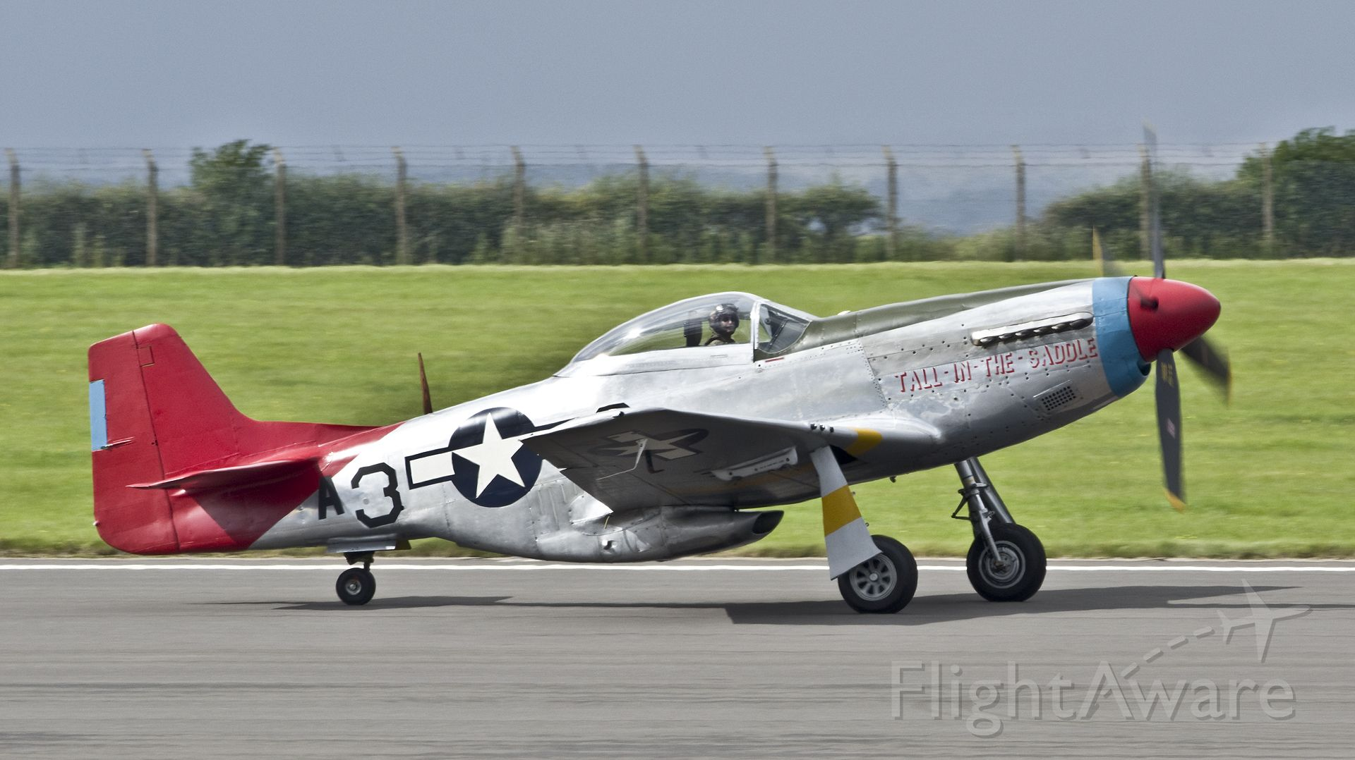 """North American P-51 Mustang (G-SIJJ) - North American P-51D Mustang 'A3-3' """"Tall-In-The-Saddle"""" (G-SIJJ).Full US military serial 44-72035.<br>Repainted for the 2016 season, this very original P-51 now wears her own genuine 'Red Tail' 332nd Fighter Group markings and is believed to be the only Mustang to have served with the group which currently remains airworthy. RAF Scampton 9th September 2017"""