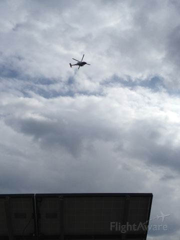 — — - Coast guard jhawk decided to do a flyby of the Wright Brothers monument