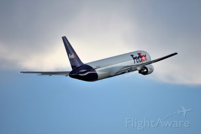 BOEING 767-300 (N273FE) - Heading off in to the weather
