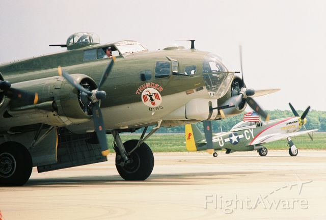 """Boeing B-17 Flying Fortress (N900RW) - Vega built Boeing B-17G, """"Thunderbird"""", N900RW, at Barksdale AFB Airshow, May 2005, with North American P-51D, """"Gunfighter"""", N5428V, in the background."""
